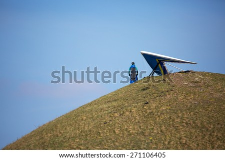 Hang glider pilot in Czech Central Mountains - stock photo