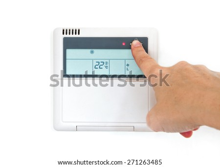Hang selecting home temperature on control panel on a white wall - stock photo