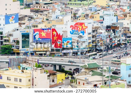 HANG XANH, SAIGON, VIET NAM - APRIL 25, 2015. There are many panels for celebrations the Reunification Day - April 30 at Hang Xanh overpass, Ho Chi Minh city. April 30 is a national holiday of Vietnam - stock photo