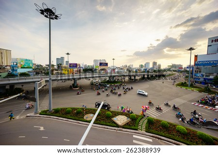 HANG XANH, SAIGON, VIET NAM - DEC 14, 2014: Circulation by vehicle at Saigon, Vietnam. People transport by motorbike, bus, taxi. With more than 4 mil. motorbikes, the traffic is often congested. - stock photo