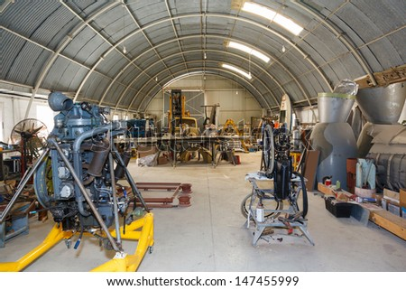 hangar workshop to the aircraft engine and parts - stock photo