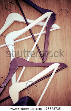 Hangers hangers on wooden background - stock photo
