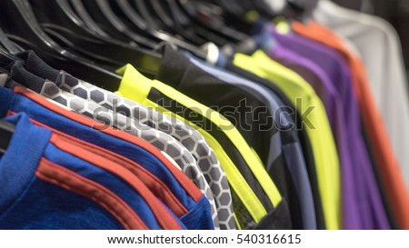 Hangers with clothes in the store. sports apparel, sportswear.