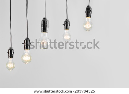 Hanging antique edison style filament light bulb - stock photo