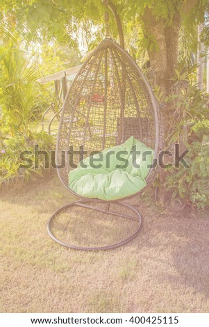 Hanging bench in the garden, Vintage Style. - stock photo