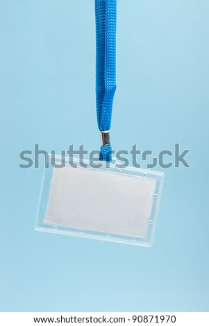Hanging blank business plastic badge with blue neck strap - stock photo