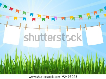 Hanging blank paper on clothesline in field. Sunny day. Festive flags. Blank white space. - stock photo