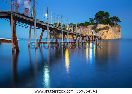 Hanging bridge to the island at night, Zakynthos in Greece - stock photo