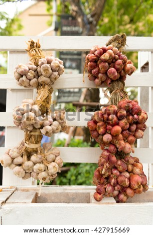Hanging bunch bundle of onion and garlic clove, Bunch of garlic and onions in a clump of colorful cooking Thailand. - stock photo
