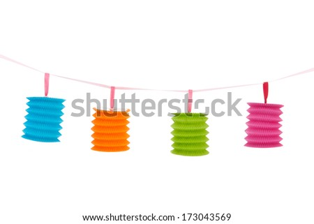 Hanging chain with colorful paper Chinese lanterns isolated over white background - stock photo
