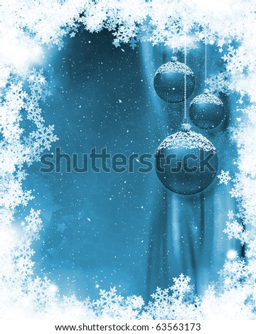 Hanging Christmas baubles on a snowflake background