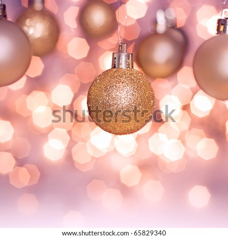 hanging Christmas decoration on gold background - stock photo