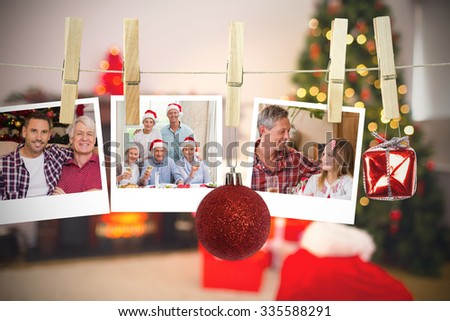Hanging christmas photos against christmas at home - stock photo