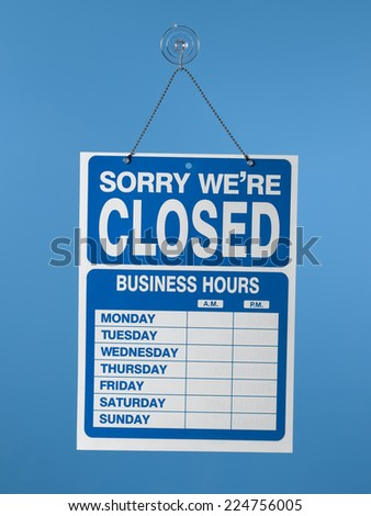 Hanging closed sign - stock photo