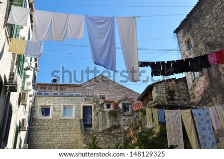 Hanging clothes in Croatian city - stock photo