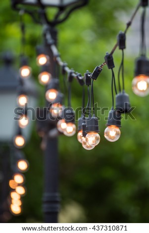 Hanging decorative christmas lights for a ceremony