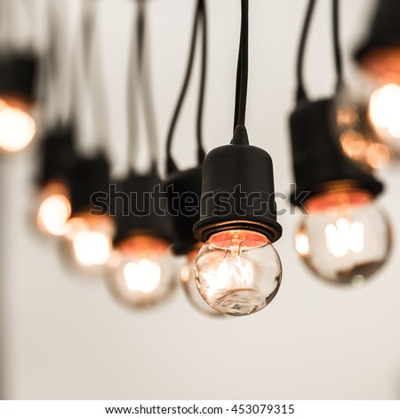 Hanging decorative christmas lights for a party - stock photo