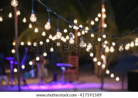 Hanging decorative lights for a wedding party - stock photo