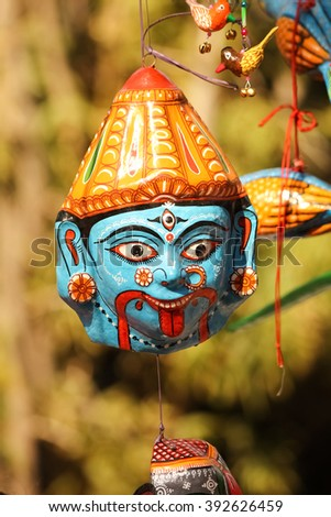 hanging face mask of goddess durga kali avatar made of clay - stock photo