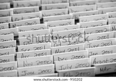 Hanging file folders, month by month beginning in 2000 - stock photo
