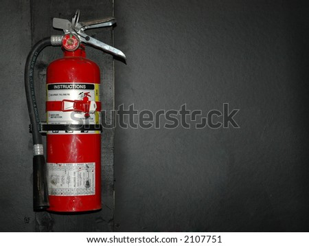 hanging fire extinguisher - stock photo