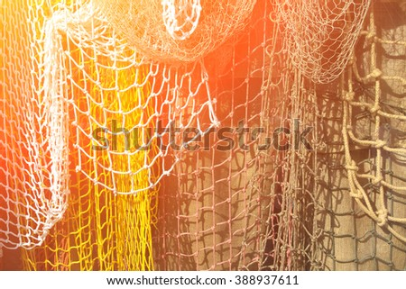 Hanging fishing nets in the background burlap, texture. Toned - stock photo