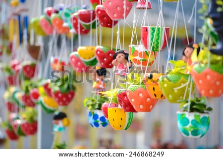 hanging flower pots made from ceramic - stock photo