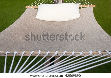 Hanging hammock with white pillow resting on top