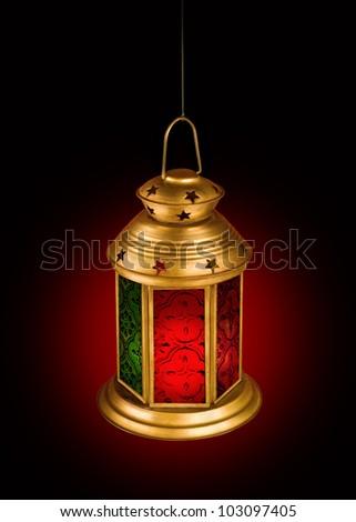 Hanging islamic lamp on dark background - stock photo