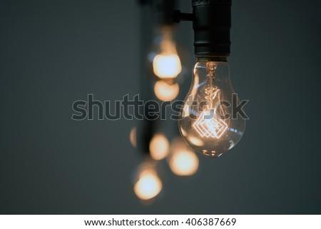 Hanging Light Bulb - stock photo
