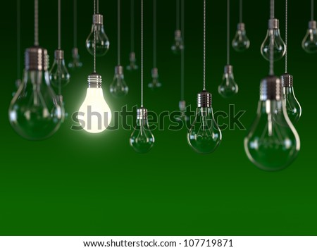 Hanging light bulbs with glowing one isolated on dark green background - stock photo