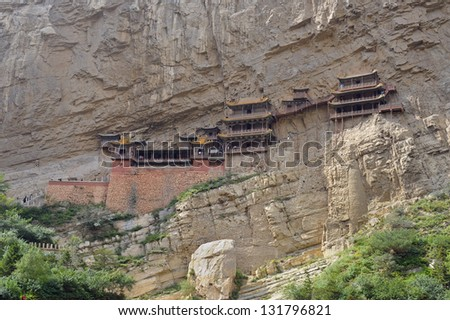 Hanging monastery temple near Datong, China. One of touristic spots in Shanxi. - stock photo