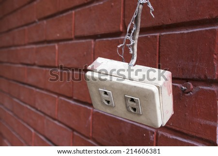hanging of remove old plug socket on brick wall