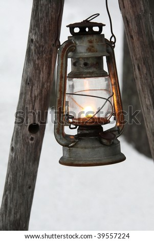 Hanging old gas lantern - stock photo