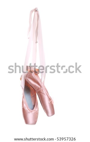 Hanging pink ballet shoes isolated on a white background - stock photo