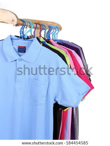 Hanging Polo shirt isolted on white background - stock photo