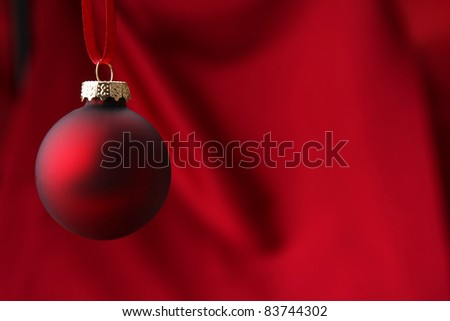 Hanging red Christmas ball. - stock photo