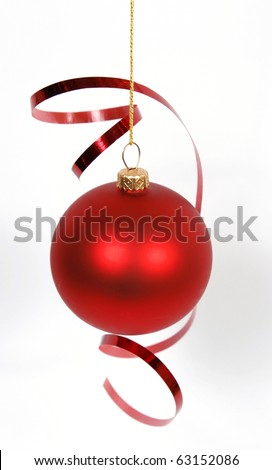 Hanging red glass ball with the ribbon on the white background - stock photo