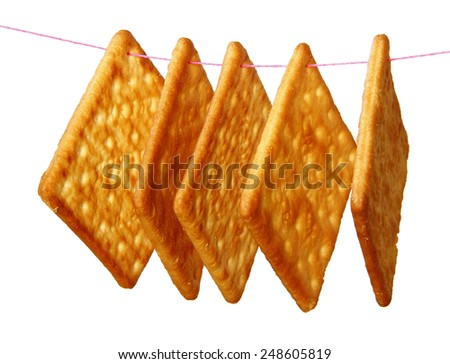 Hanging Salty Crackers are on white background. - stock photo