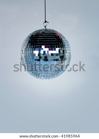 Hanging shiny silver disco ball - stock photo