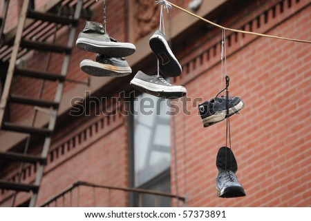 Hanging shoes from a wire. - stock photo