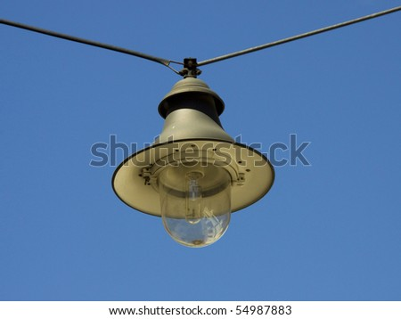 hanging street lamp with clear blue sky - stock photo