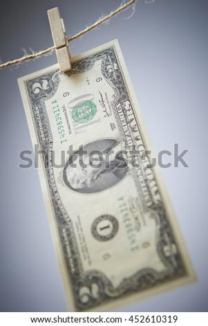 Hanging US dollar bill - stock photo