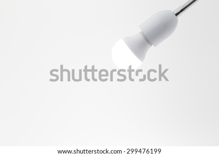 hanging white lamp with white wall background - stock photo