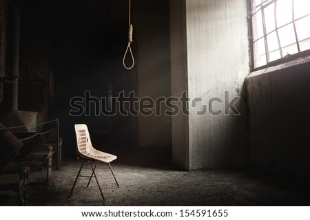 Hangman Noose with thirteen loops setup in an abandoned building. Beautiful rays of light coming from the window. - stock photo