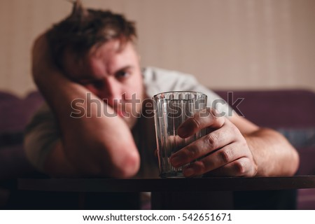 Hangover depressed man after hard drinking.