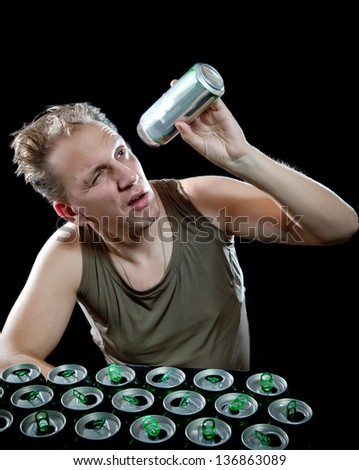 Hangover. The man examines, whether there is no beer drop in a can - stock photo