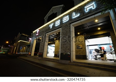 Hangzhou, China - Sept. 23, 2015: New Tesla Model S showroom has arrived in Hangzhou, China. Tesla is an American company that designs, manufactures, and sells electric cars - stock photo