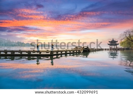 hangzhou scenery, sunset glow reflection in west lake ,China - stock photo