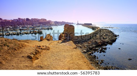 Hania harbour and old town, Crete, Greece, seen from the old city wall at the east end. - stock photo